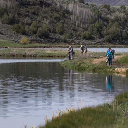 A group of fly fishers with Jans Expert guides at a lake in the Uinta Mountains