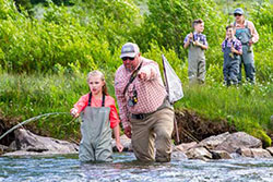 fly fishing instructor points out where student should cast