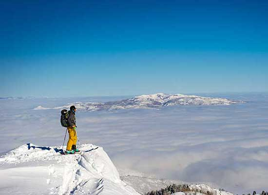 Backcountry skier standing on a Utah mountain top