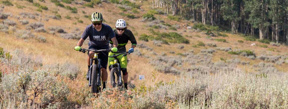 Jans Experts Paul Boyle and Kevin Holliday ride in a high-alpine open meadow in Park City, UT