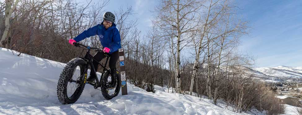 A fat biker rides a snowpacked trail in Park City, UT